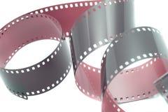 Gekrulde omhoog strook van film over wit Royalty-vrije Stock Fotografie