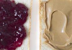 Gelée contre le beurre d'arachide Photographie stock libre de droits
