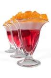Gelée de trois desserts sur le fond blanc Photos stock