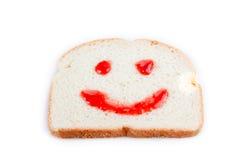Geléia feliz da face no pão Fotografia de Stock