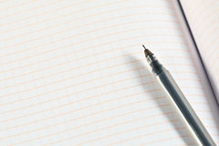 Gel ballpoint pen from transparent plastic over the sheet Royalty Free Stock Photo