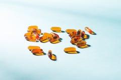 Gel Capsules.  Vitamin A, E, fish oil, primrose oil, rice barn o Stock Photos
