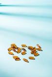 Gel Capsules.  Vitamin A, E, fish oil, primrose oil, rice barn o Royalty Free Stock Image