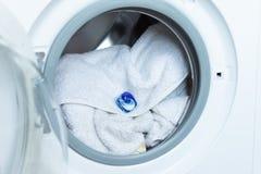 Gel de lavagem em uma máquina de lavar imagens de stock royalty free