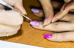 Gel nail extensions and nail design work Royalty Free Stock Photography
