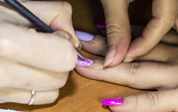 Gel nail extensions and nail design work Stock Photo