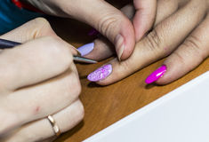 Gel nail extensions and nail design work Stock Images