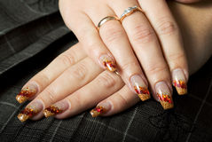 Gel nails with decoration. Stock Photography