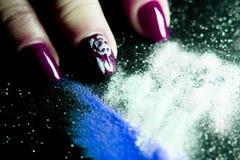 Gel nails next to acrylic powder to make them