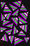 Gel pen drawing with colorful triangles. A gel pen drawing of colorful triangles on black background Stock Photo
