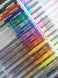 Colored pens. Gel pens in multi colors royalty free stock photography
