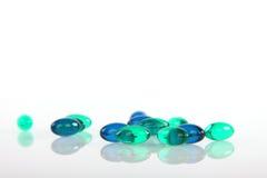 Gel pills on white Stock Photos