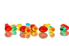 Gel pills on white Royalty Free Stock Photos