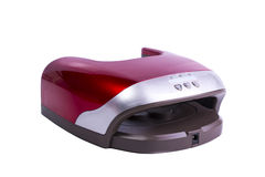 Gel rouge de manucure traitant la lampe d'isolement sur le blanc Photographie stock libre de droits
