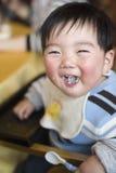 Gelachen baby Stock Afbeelding