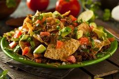 Geladene Rindfleisch und Käse Nachos Lizenzfreies Stockfoto