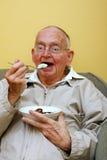 Gelado sênior comer Imagem de Stock Royalty Free