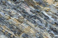 Gelamineerde steen De grijs-gele achtergrond van het leiclose-up royalty-vrije stock afbeeldingen