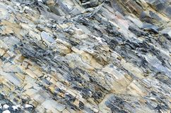 Gelamineerde steen De grijs-gele achtergrond van het leiclose-up royalty-vrije stock foto's