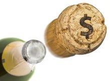 Gelanceerde champagnecork met de vorm van een gebrand Dollarsymbool Royalty-vrije Stock Foto's
