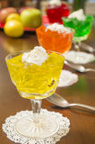 Gelatin dessert. Colorful gelatin desserts lined up on a table ready to enjoy stock photo