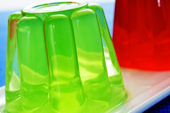 Gelatin desserts. Closeup of a plate with refreshing gelatin desserts of different flavors and colors royalty free stock photography