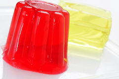 Gelatin desserts. Closeup of a plate with refreshing gelatin desserts of different flavors and colors royalty free stock images