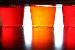 Gelatin reflections. Gelatin sitting on a table with reflecting colors Stock Photo