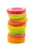 Gelatine el dulce, fruta del sabor, postre del caramelo colorido en el backg blanco Imagen de archivo libre de regalías