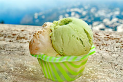 Gelato happiness on the island of Capri. Close up of two scoops of pistachio and hazelnut gelato in a cup on the island of Capri, Italy Royalty Free Stock Photo