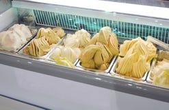 Gelato Italian ice cream mixed cream and fruits on box in electric freezer cabinet Stock Photography