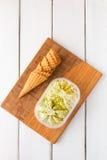 Gelato italiano di gelato del pistacchio in scatola Fotografia Stock Libera da Diritti