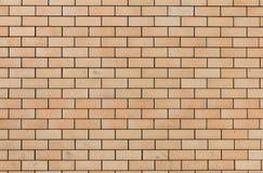 Gelb-orangeer Backsteinmauerhintergrund, gemasert, Muster Stockbilder