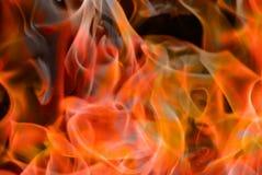 Gelb-orangeer Flammennahaufnahmehintergrund lizenzfreie stockfotos