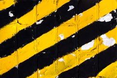 Gelbe abstrakte Hintergrundbeschaffenheit der alten Wand Stockfotos