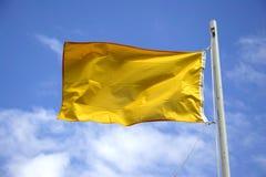 Gelbe Achtung-Markierungsfahne Stockfotografie