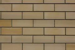 Gelbe Backsteinmauer Lizenzfreie Stockbilder