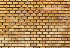 Gelbe Backsteinmauerbeschaffenheit Stockfoto