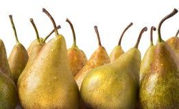 gelbe Birnen über weißem Hintergrund stockbilder