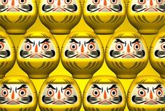 Gelbe Daruma-Puppen auf Gelb Stockbilder