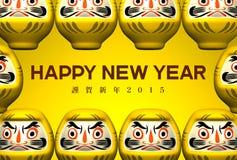 Gelbe Daruma-Puppen, grüßend auf Gelb Lizenzfreies Stockfoto