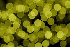 Gelbe Defocused Leuchten Stockfoto