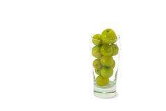 Gelbe Frucht im Glas Stockfotos