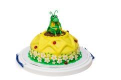 Gelbe Geburtstagskuchensonnenblume mit Heuschrecke Lizenzfreie Stockfotografie