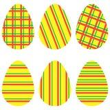 Gelbe gestreifte Eier Stockfoto