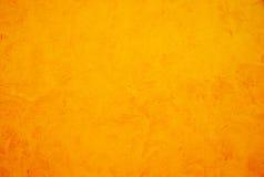 Gelbe grunge Wand, strukturierter Hintergrund Stockbild