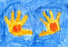 Gelbe Hände auf dem blauen Hintergrund Stockbilder