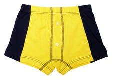 Gelbe Hosen für ein Kind auf Weiß Stockfotografie