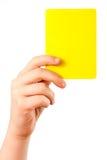 Gelbe Karte in der Hand Stockfotos