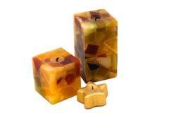 Gelbe Kerzen mit Goldsternkerze Lizenzfreies Stockbild